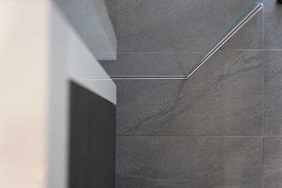 Large format rectangular bathroom floor tiles in grey with marble effect
