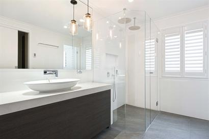 Light airy bathroom with freestanding basin and large frameless shower