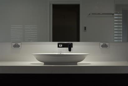 Classic freestanding basin and tapware with dramatic spot lighting
