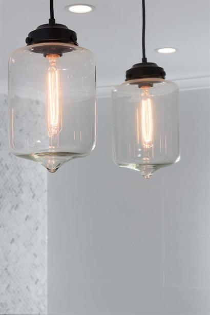Modern bathroom lighting with hand-blown glass pendant lights and LED downlights