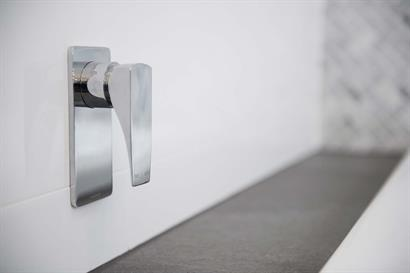 Phoenix wall-mounted tap mixer in chrome combining square edges and soft curves