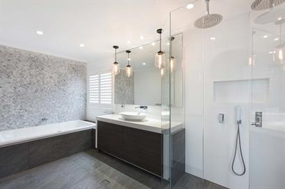 Sleek bathroom with marble and woodgrain accent features