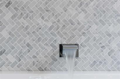 Contemporary wall-mounted waterfall tap for modern bathroom
