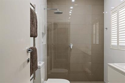 Large frameless shower with overhead rose