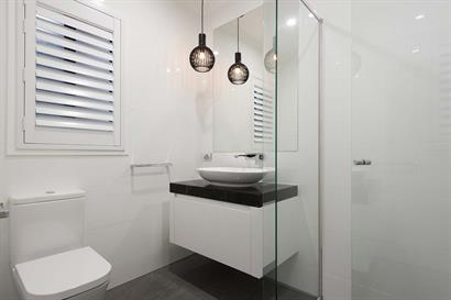 Compact ensuite bathroom with frameless shower and small floating bathroom cabinet