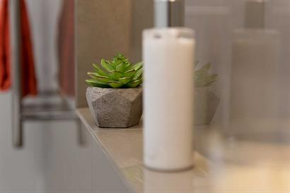 Bathroom accessories to create designer look in wall inset
