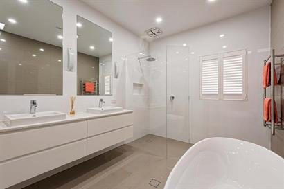 Frameless corner shower and twin basins in white gloss floating cabinets