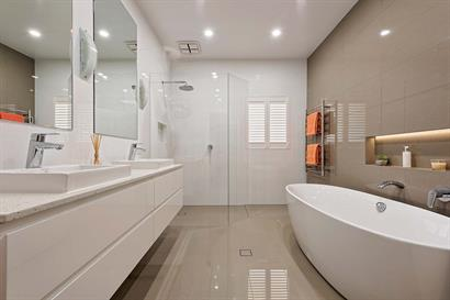 Large bathroom with freestanding bathtub and corner shower
