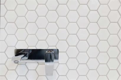 White hexagonal bathroom wall ties with Phoenix tap and mixer set