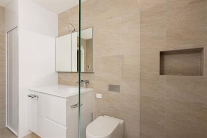Recessed shower shelf, frameless Superclear low iron shower panel.