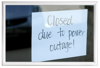 Closed due to power outages sign on door