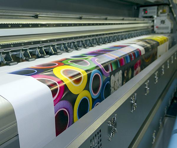 large format industrial inkjet printer printing a colorful vinyl sign