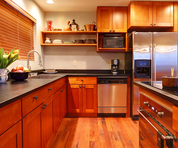 kitchen with wood cabinets and floors