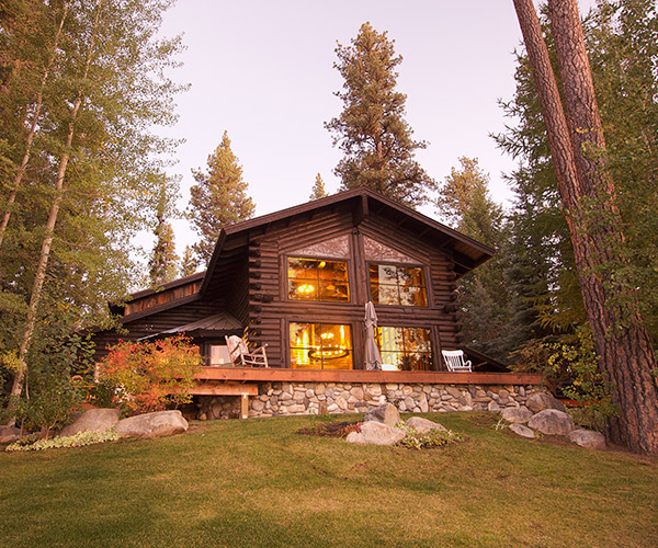 a log home exterior among the pines