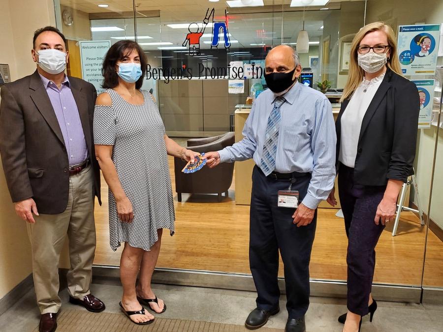 Dean Pastras accepts Food Brigade donation of $5000