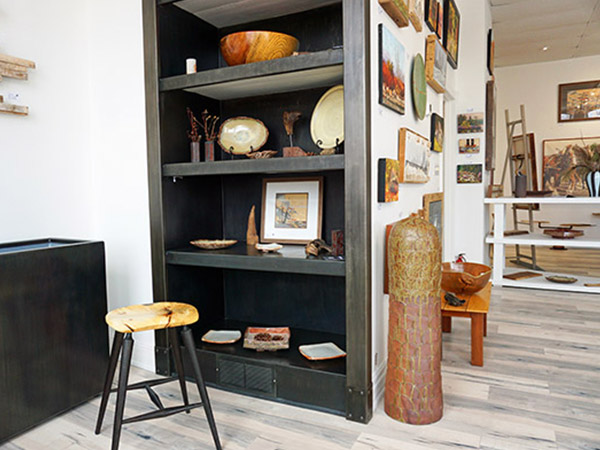 painted wooden shelves with art and wooden bowls