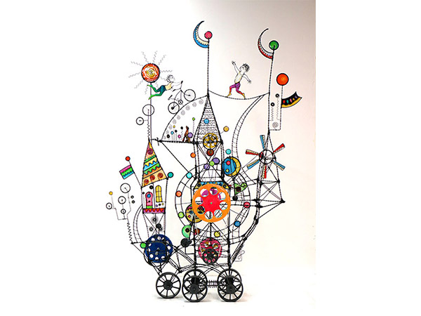 whimsical sculpture on wheels with wire and colour inserts