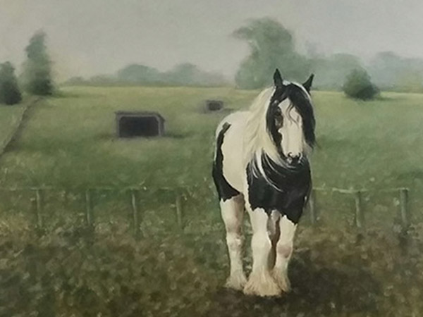 painting of a black and white horse in a field