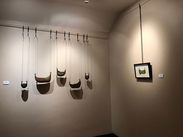art objects hanging on gallery wall