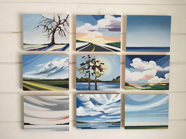 nine small paintings hanging on a wall.