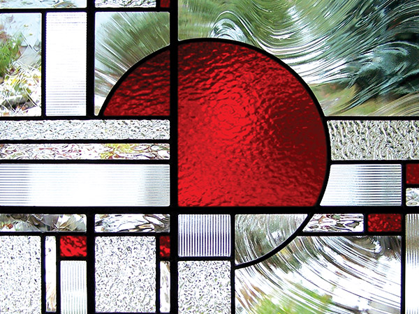 stained glass panel with red part circle.