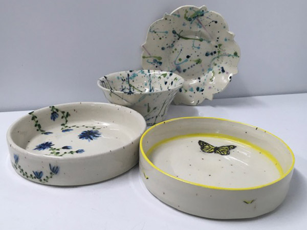 grey and blue speckled pottery bowls, plate and two pans.