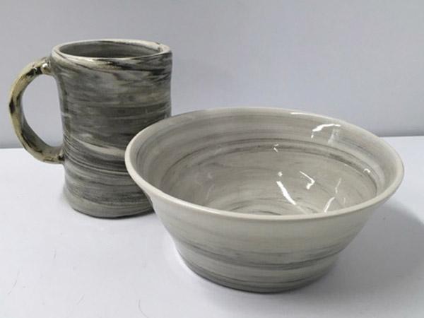 grey pottery mug and bowl.
