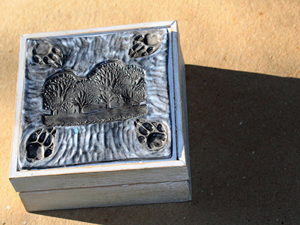 pottery box with foot prints.