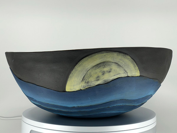 Large pottery bowl with graphic.