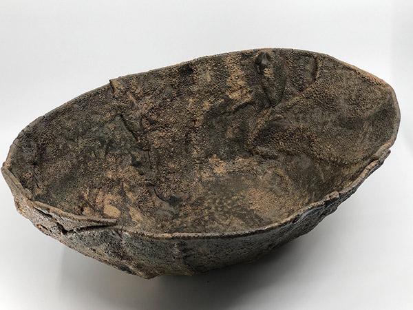 large bronze pottery bowl.
