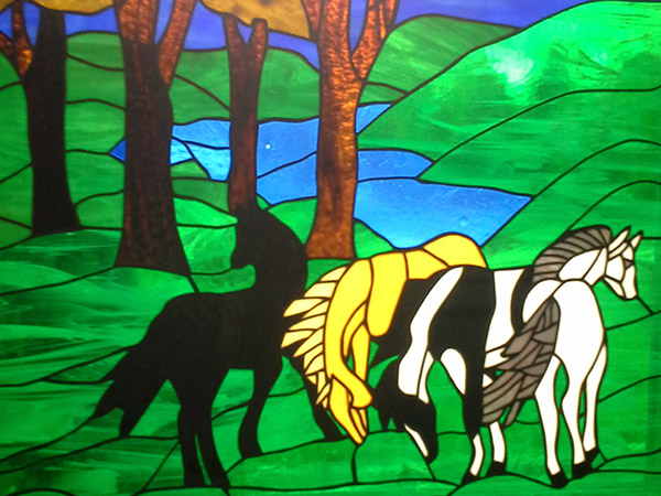 Stained glass horse artwork.