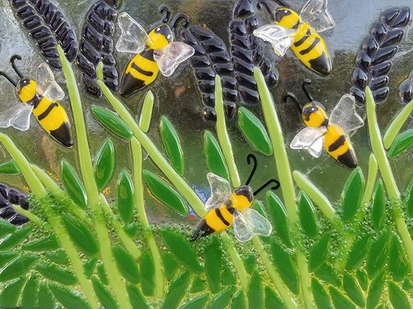 Fused glass bee artwork.