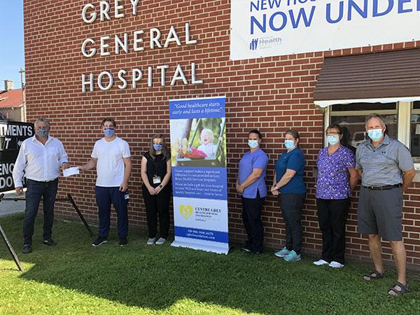 Stonebrook Developments presents golf memberships to Markdale hospital staff