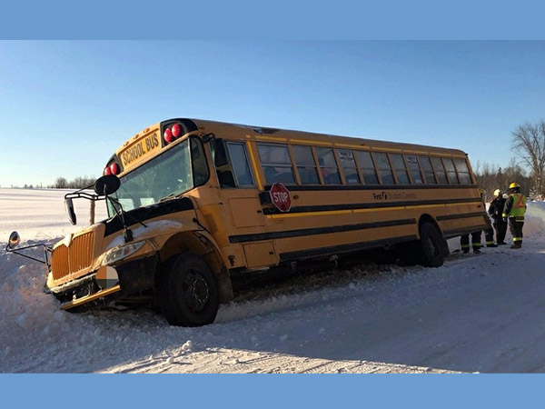 school bus stuck in the ditch filled with snow
