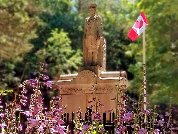 Eugenia Cenotaph with Canadian flag