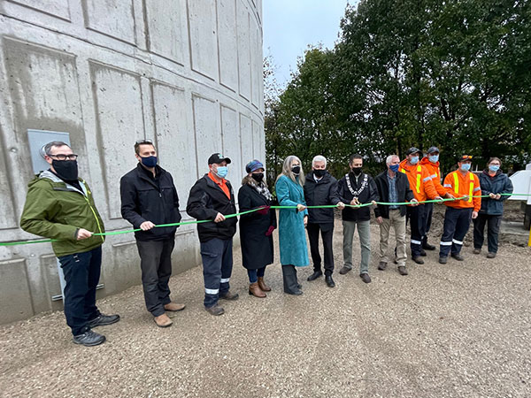 staff and dignitaries cut the ribbon to open the Markdale water tower
