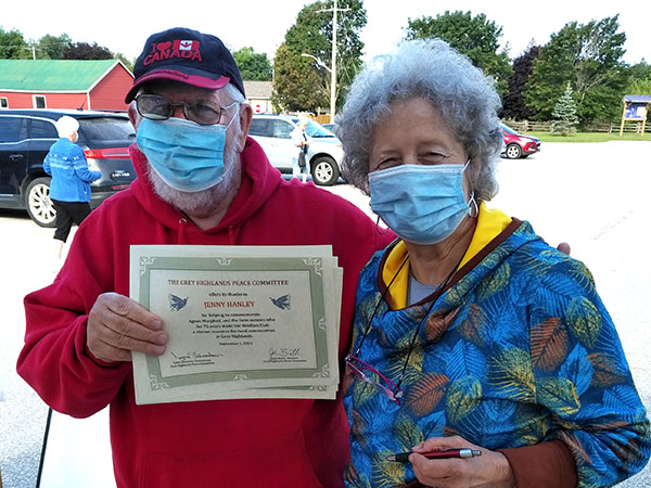 John Butler and Lynn Silverton hold Peace Committee certificate