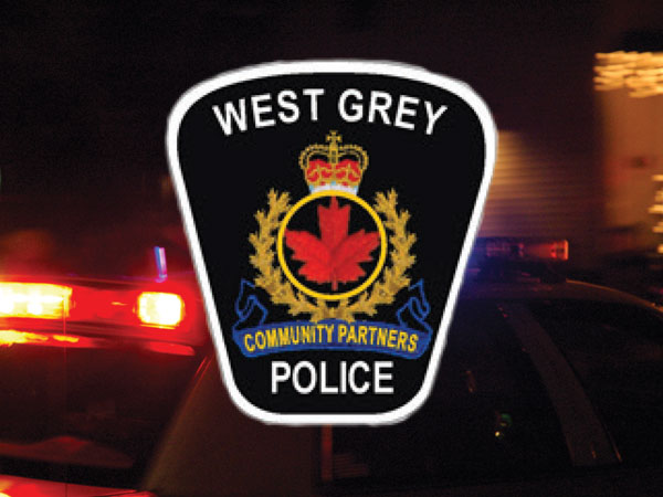West Grey Police logo and car on the road