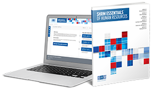 SHRM Essentials on a laptop and book