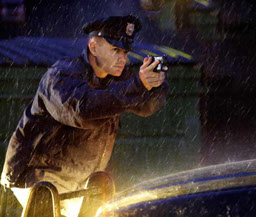 Police Officer In Rain