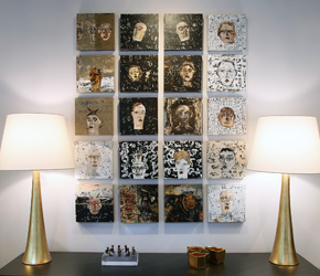 A grid arrangement of contemporary artwork by Mark Westervelt between luxury lamps by AERIN