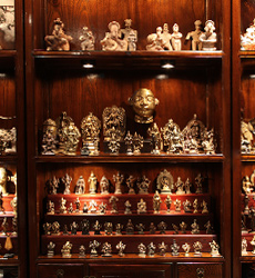 Miniature bronzes and other curios are interesting to explore when displayed in intriguing ways