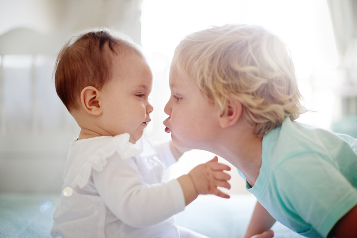 Why Kids Hit Younger Siblings, and How To Help Them Stop